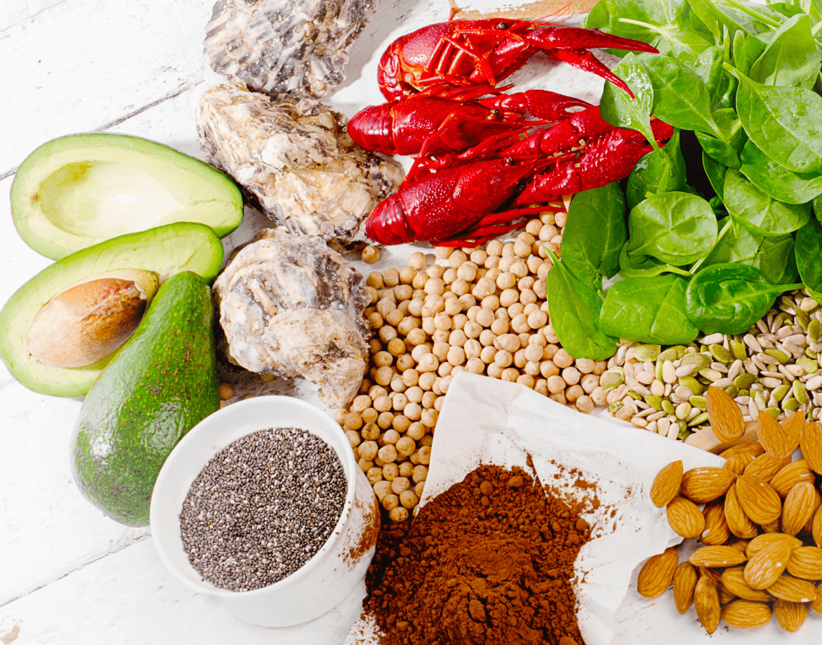 foods rich in the mineral zinc including avocados, oysters, lobster, spinach, beans, almonds, cacao, and chia seeds
