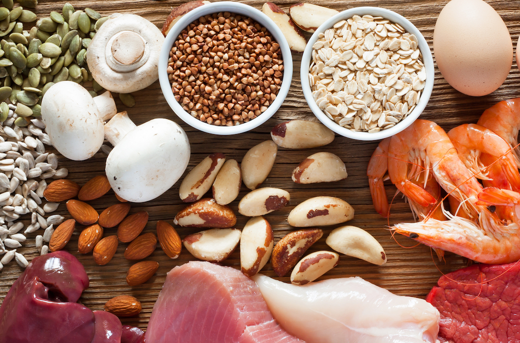 Foods containing the trace mineral selenium, including brazil nuts, almonds, mushrooms, oats, eggs, pumpkin seeds, flaxseeds, fish, chicken, liver, and meat