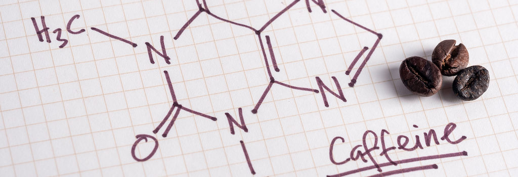 chemical formula for caffeine with three coffee beans on the side