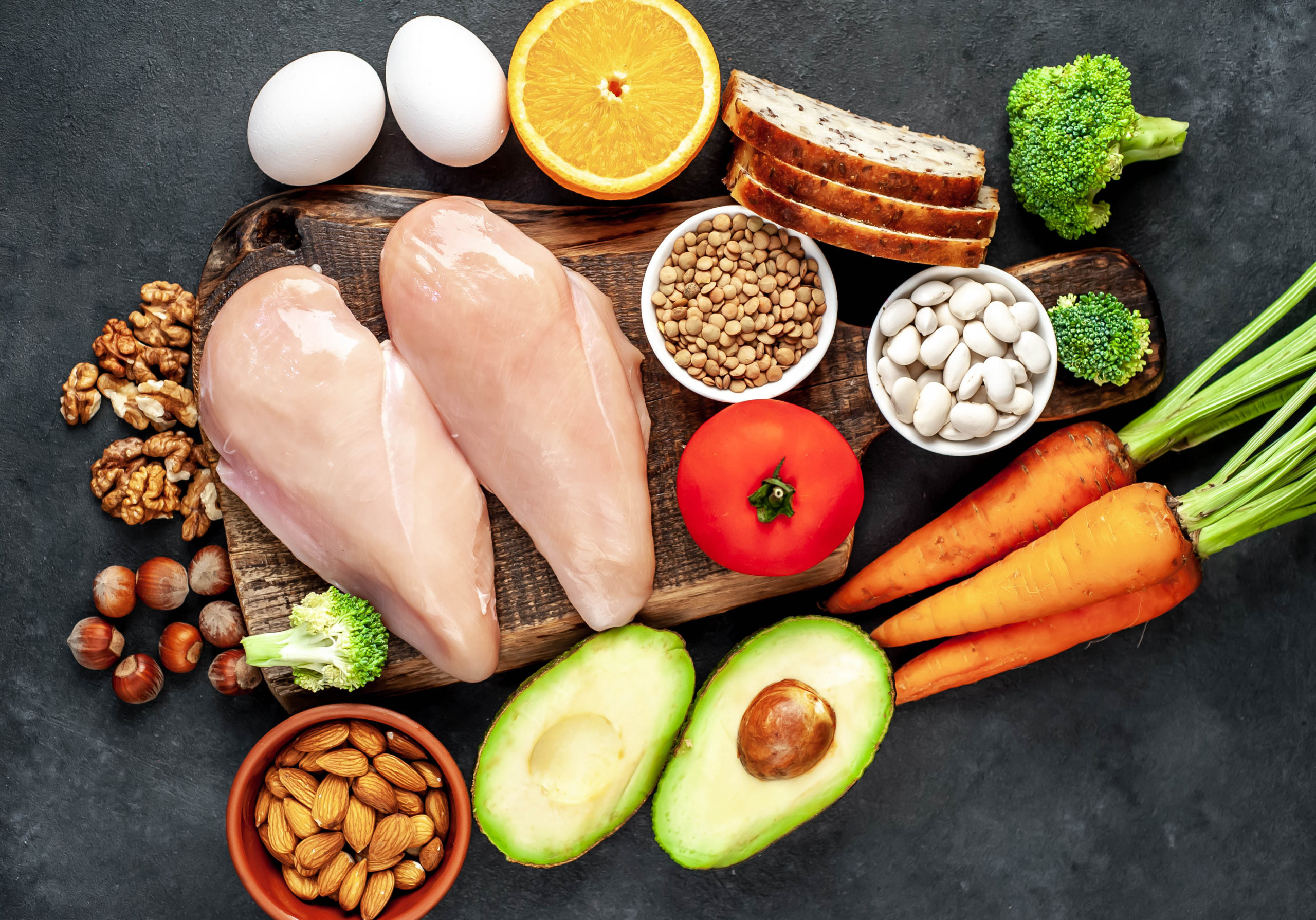 A range of foods high in Niacin (or Vitamin B3) including legumes, nuts, seeds, carrots, chicken, avocado, eggs, grains, broccoli