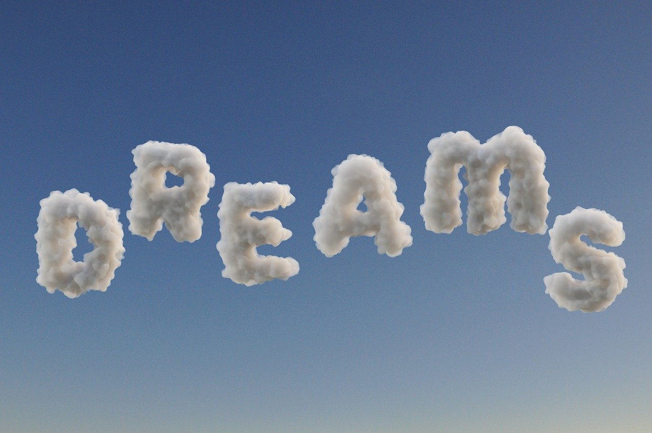 the word dreams spelled out in cloud letters