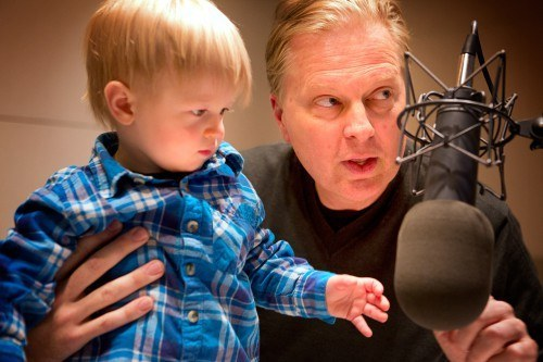 Host Tom Ashbrook shows Nolan where to stand in order to reach the studio's mic. (Jese Costa / WBUR)