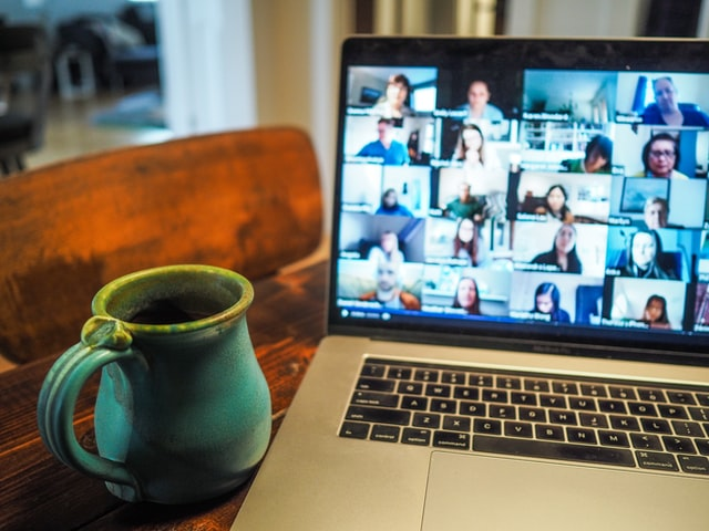 Zoom call with coffee, photo by Chris Montgomery on Unsplash