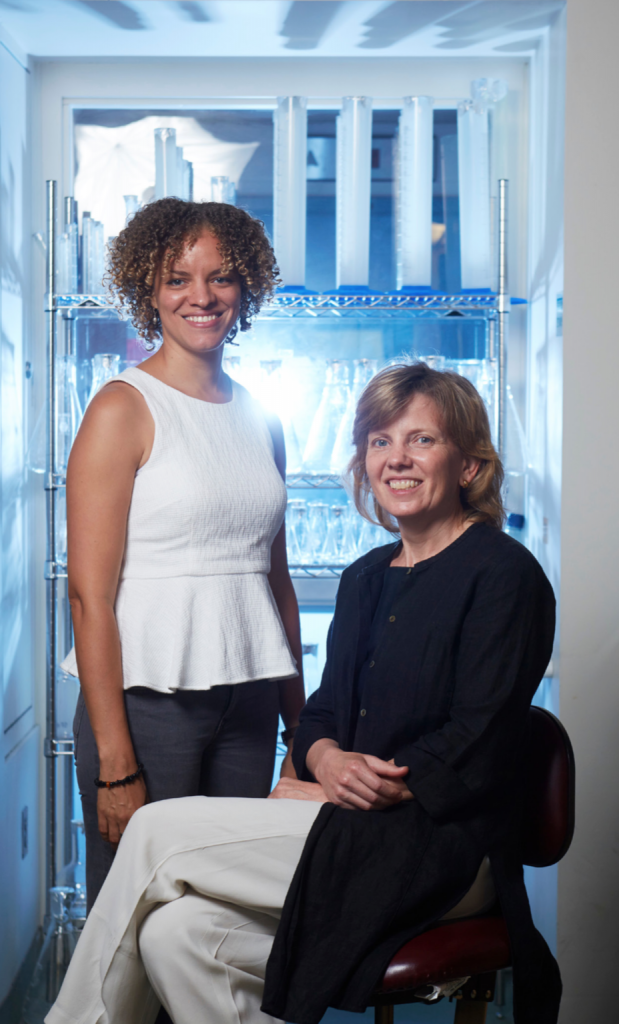"""""""A lot of our fundamental understanding of TB comes out of studies of the 19th and early 20th century. And frankly, a lot of our assumptions about how TB causes disease are wrong."""" —Sarah Fortune, professor of immunology and infectious diseases (seated at right), with lab member Jemila Kester, PhD '17"""