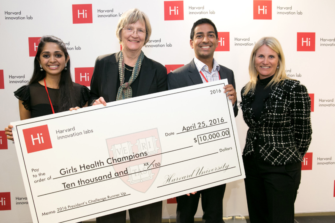 Girls Health Champions earned runner-up honors in Harvard's President's Challenge. From left, Priya Shankar, MPH '16; Harvard President Drew Faust, Ricky Sharma, MPP '18; and Jodi Goldstein, the Bruce and Bridgitt Evans Managing Director of the Harvard Innovation Labs. The team also received $5,000 for placing as finalists. Evgenia Eliseeva/Eve Photography