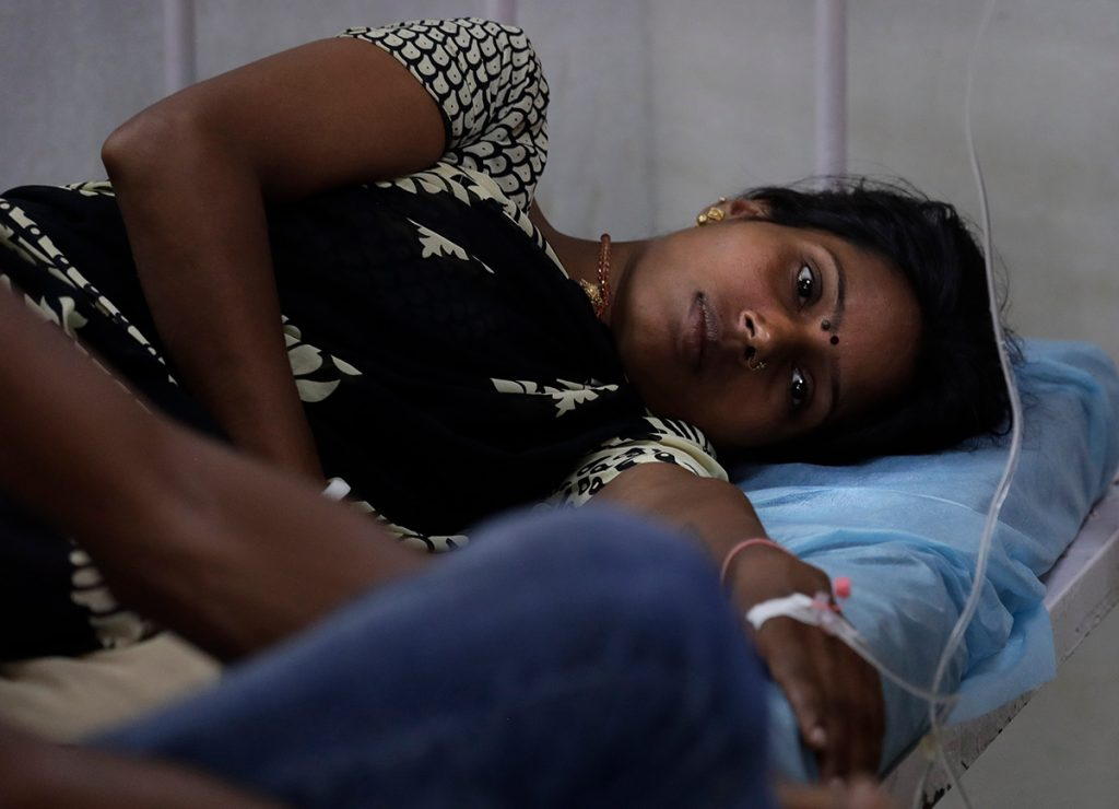 woman receives treatment at a clinic in New Delhi, India