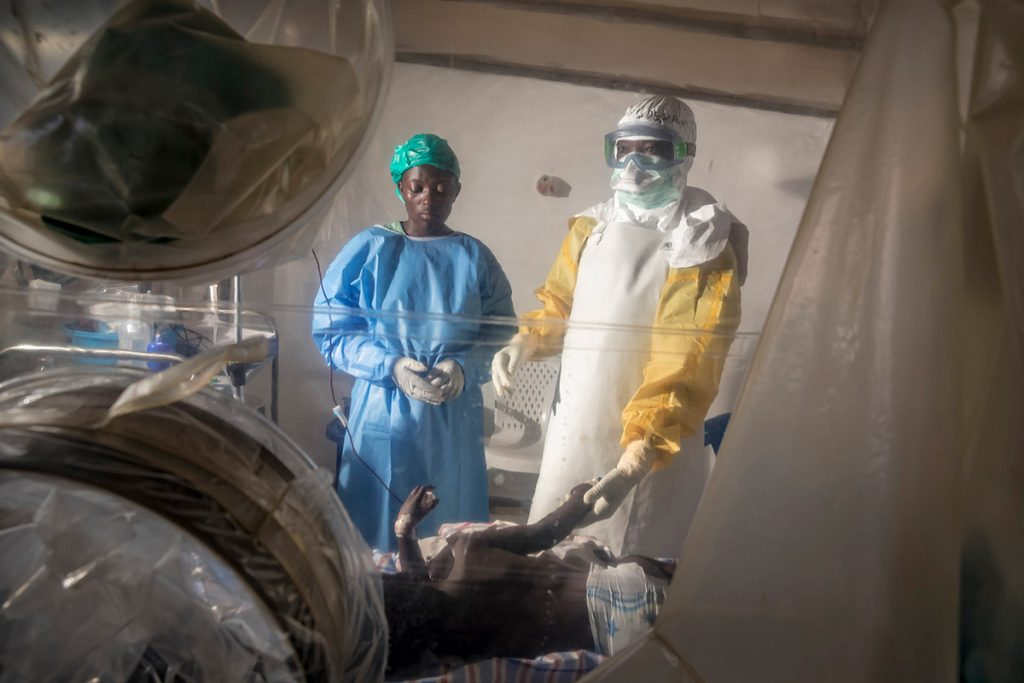A doctor and medical worker care for an Ebola patient