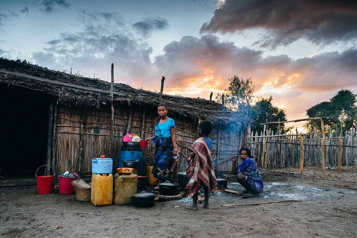 In the arid ecosystem of the Morombe region, southwestern Madagascar, villagers store water from a distant lake and underground source in jugs and use it for outdoor cooking.