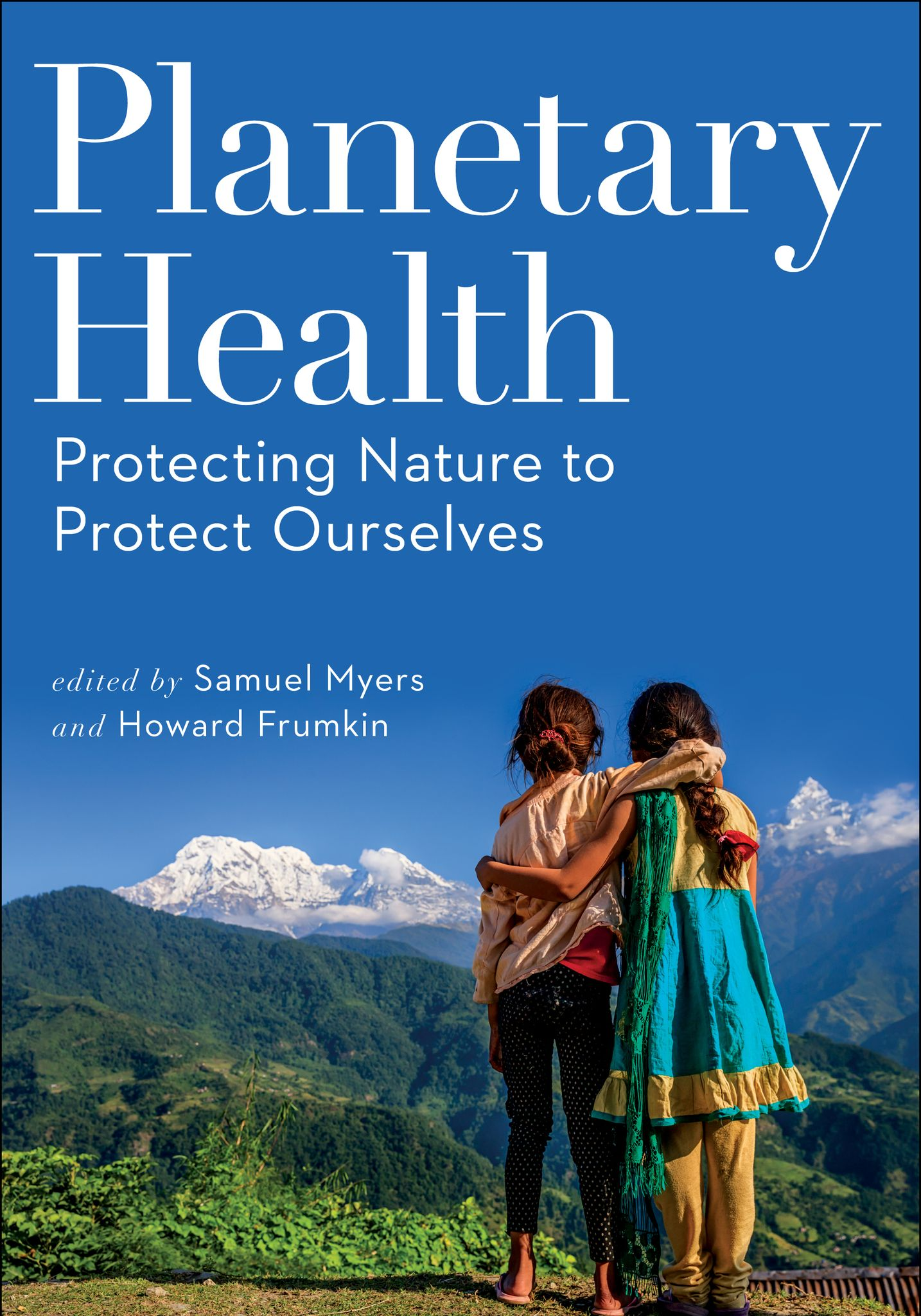 Book cover, two children embrace and look at mountains