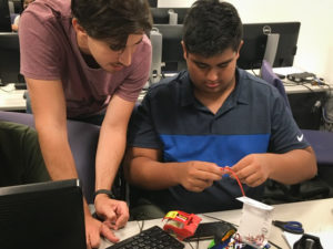Data Science summer program student working with instructor