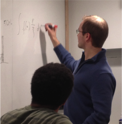 Dry work: former lab member Pekka Marttinen sketches out an idea on the whiteboard in lab meeting