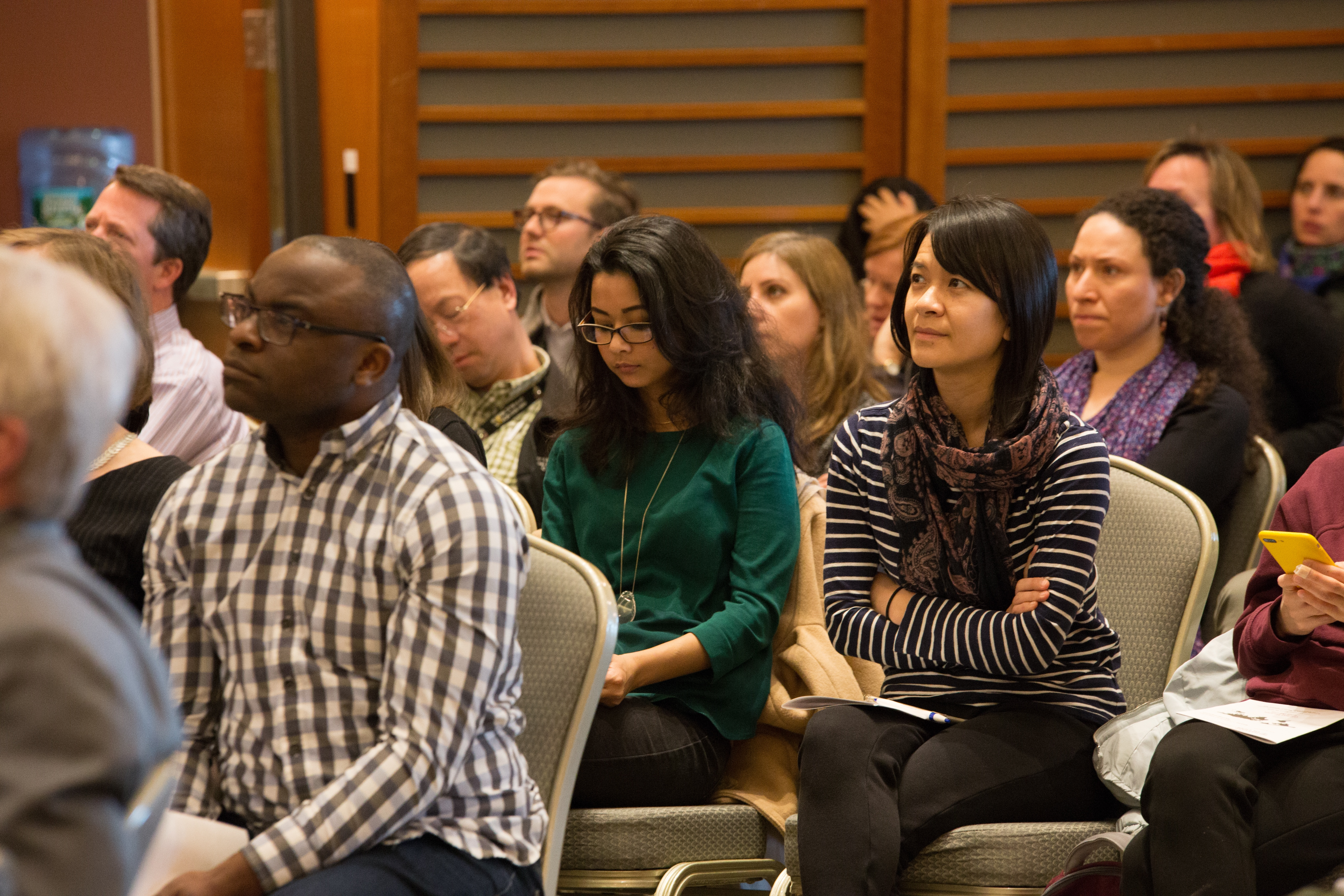 An audience listens to a lecture during Global Health Week