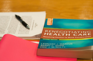 miscellaneous papers and a textbook on renegotiating health care