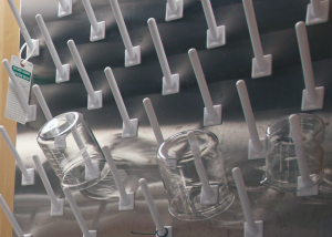 Lab glass containers hanging on a rack wall