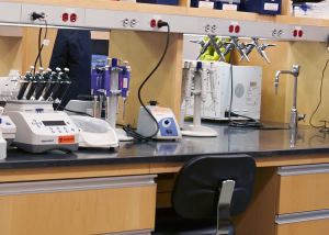 photo showing tools and technologies on top of a lab bench