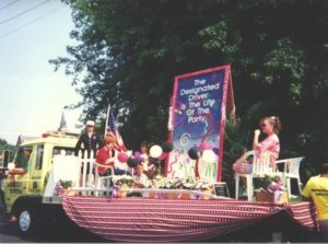 "Children on parade float featuring U.S. Designated Driver Campaign ad: The Designated Driver Is the Life of the Party"" (Harvard Alcohol Project)"