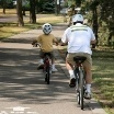 boy and father on bikes thumbnail (boy_and_father_on_bikes_104x104.jpg)