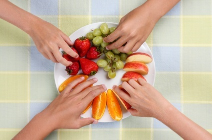 kids reaching for fruit (kids_hands_reaching_for_fruit.jpg)