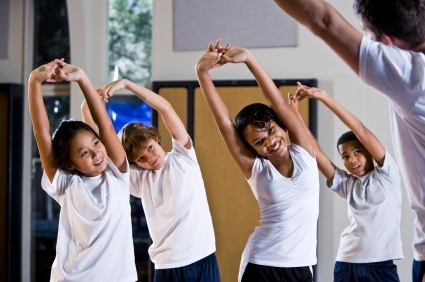kids stretching in gym (kids_stretching_in_gym_class.jpg)