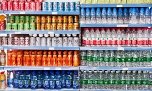 Grocery store shelves of sugary drinks and bottles of water