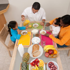 Family at the dinner table eating healthy food