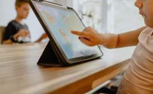 Child learning on a tablet at home